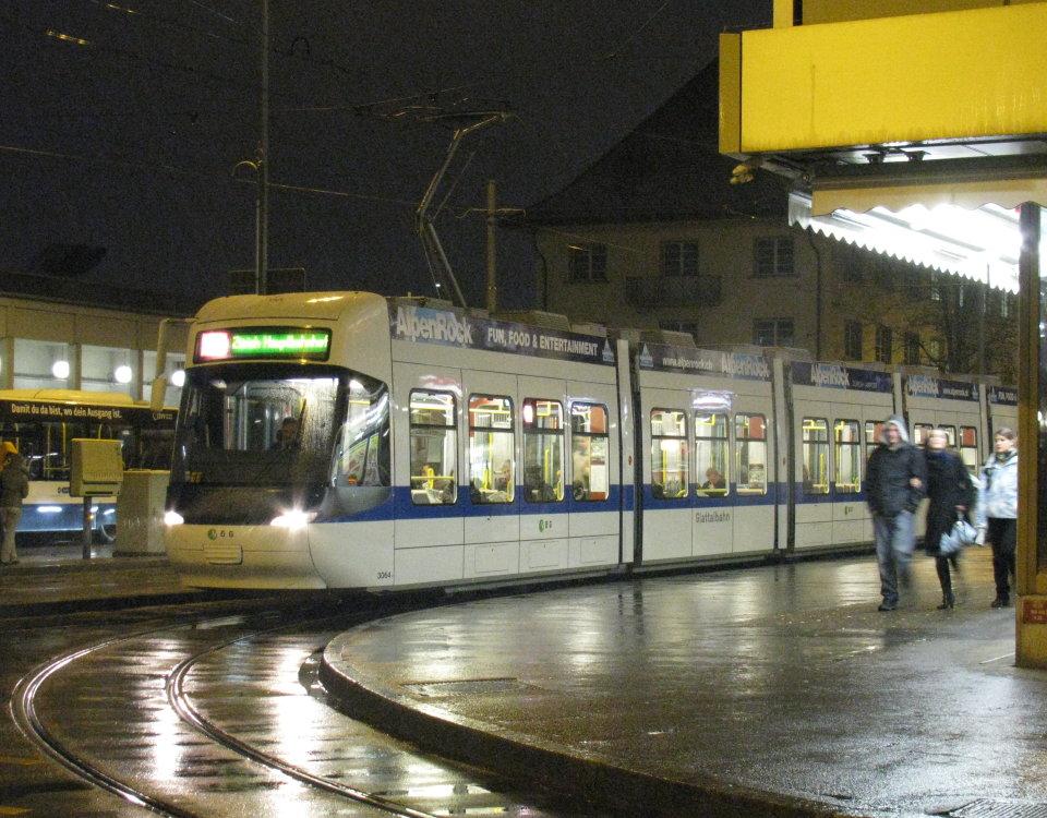 Cobra tram at night in Oerlikon