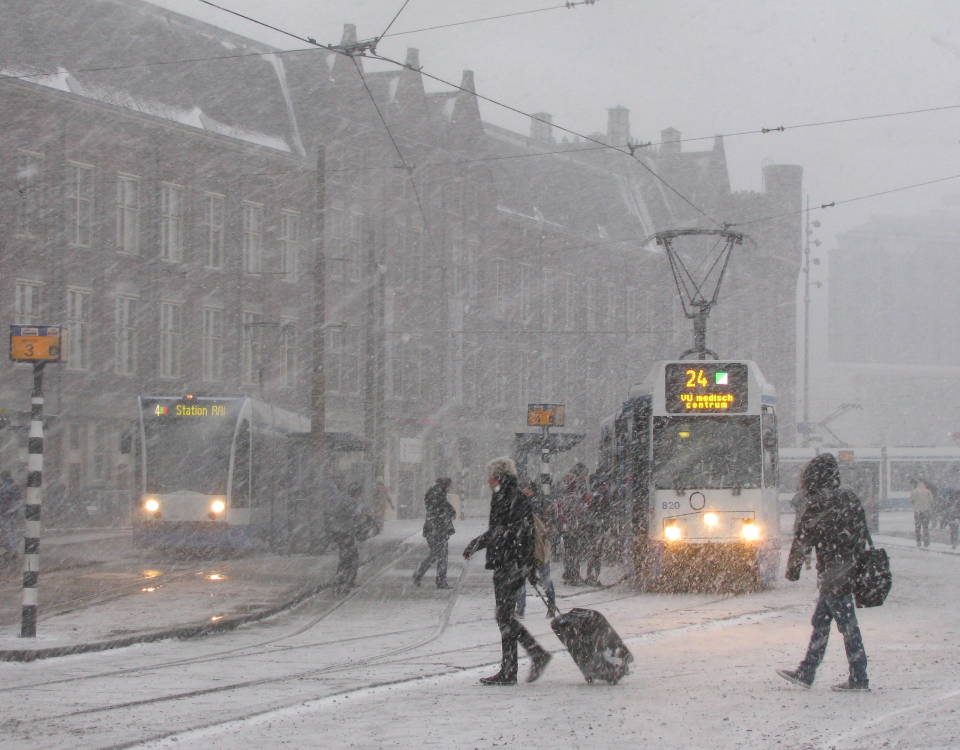 Trams and snow in Amsterdam