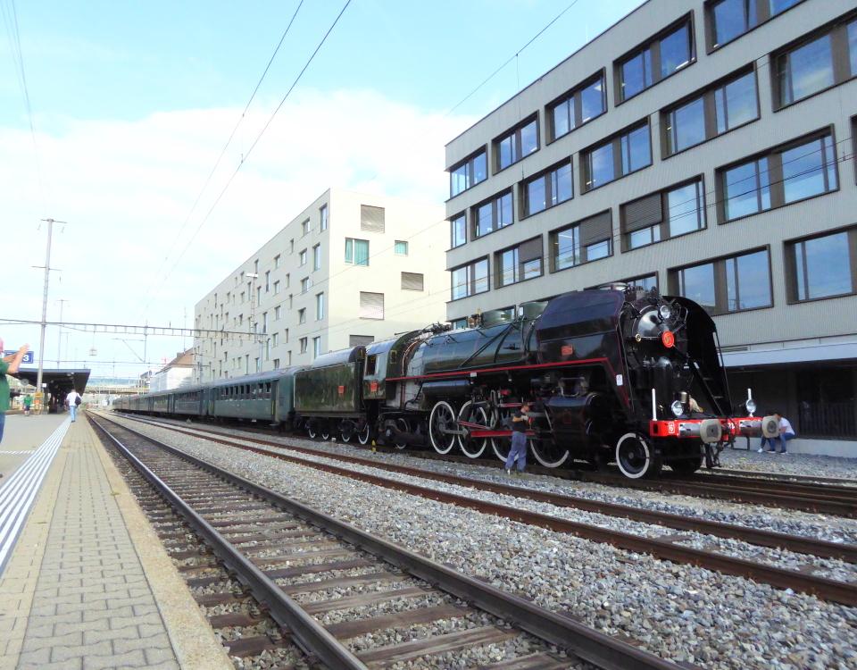 steam locomotive at opening of new tram line in schlieren